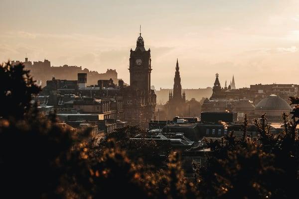 Edinburgh city castle clock tower sunrise sunset