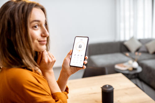 woman uses security app on her smartphone