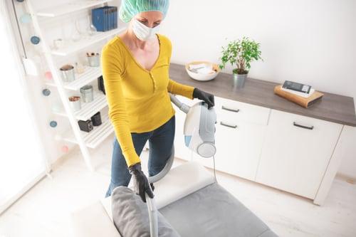 vacumming and sanitising kitchen