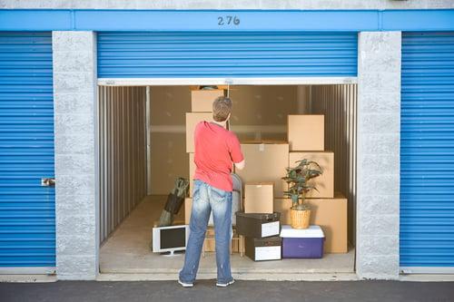 man closes door on storage closet