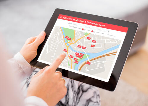 person using iPad to search local short let properties