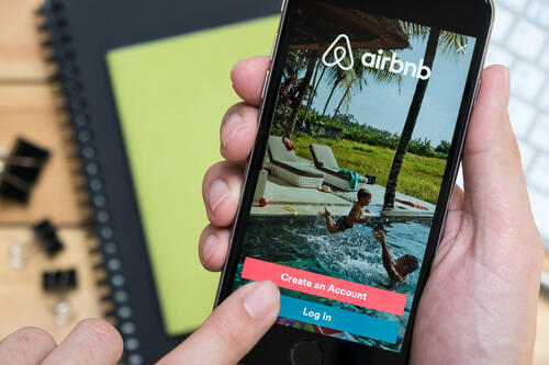 Apple iPhone with Airbnb application on the screen