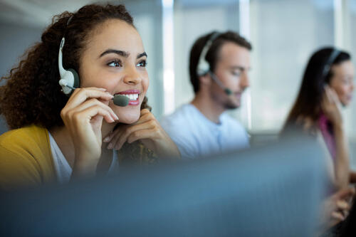 cheerful young woman answers customer support line