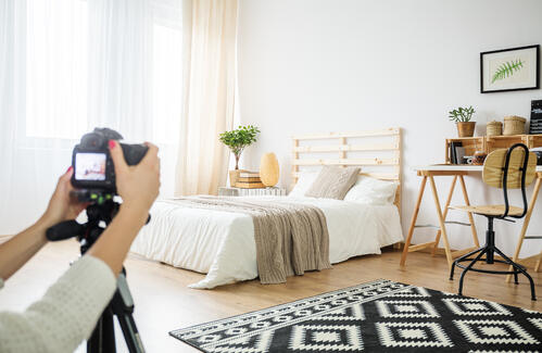 Architect making a photo of interior arrangement in eco style