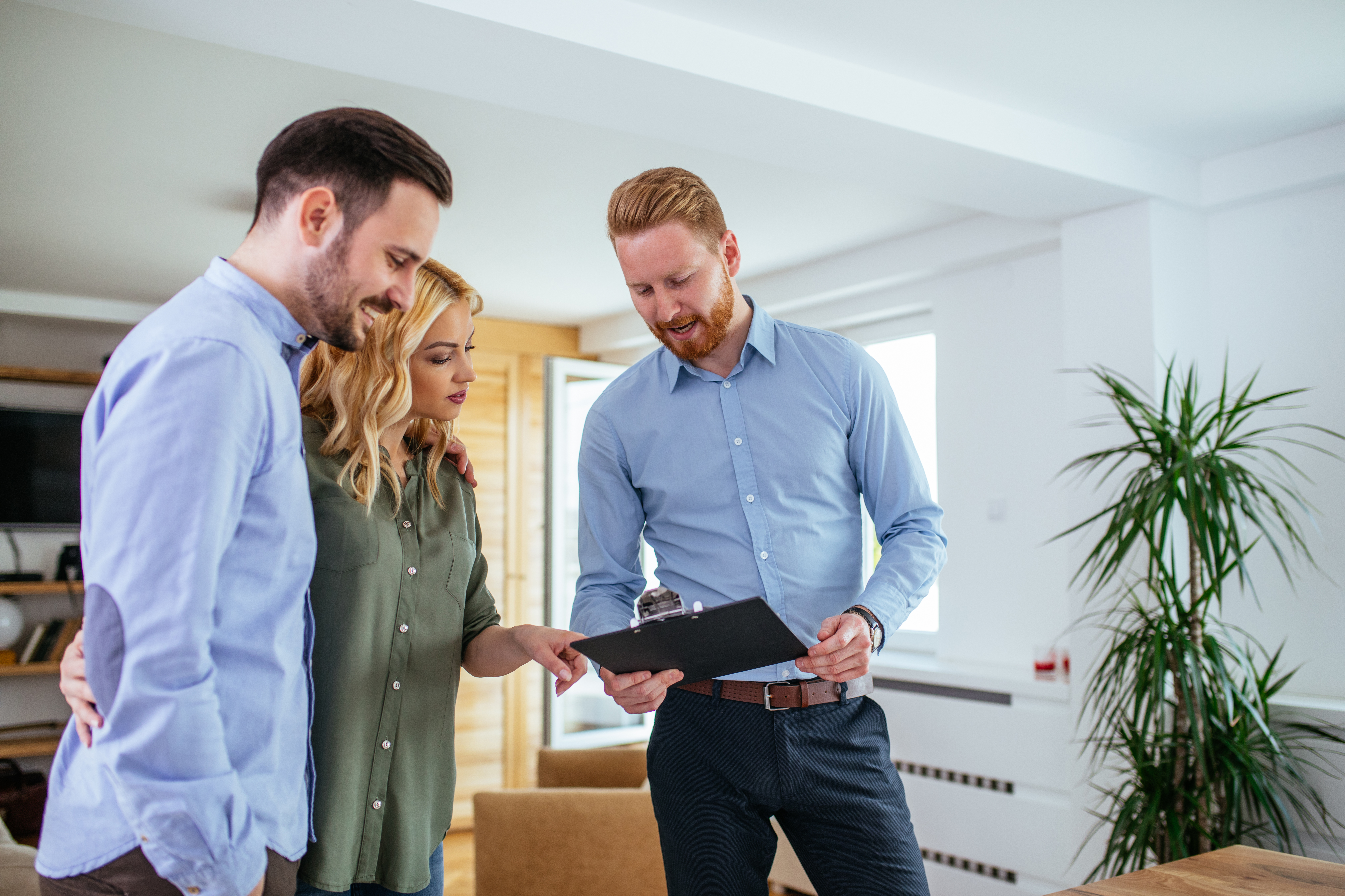 young couple consult with property manager